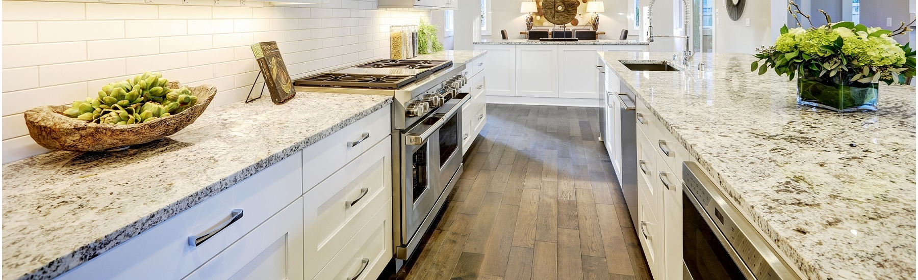 Luxurious white kitchen with granite counter tops