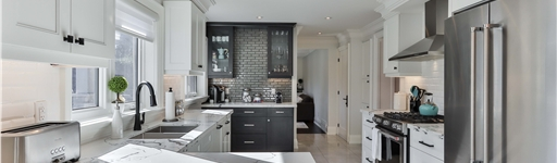 Kitchen with marble counters and tile hob backsplash